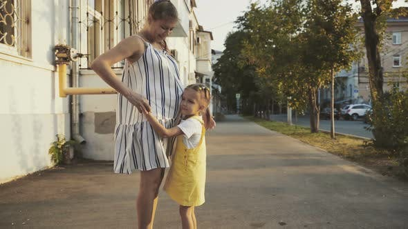 Thumbnail for Family Little Girl Child With Mother Walking City Streets At Sunset