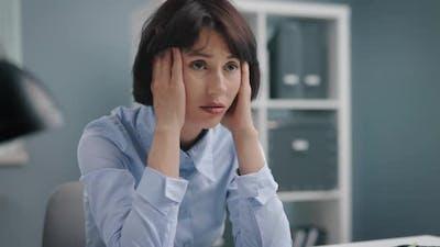 Sad Woman Sitting at Office