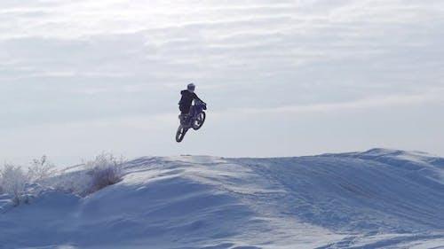 Motorcycles, Children Bikers Rider on Snowy Motocross Track. Rider on Snow. Motocross Rider on Bike