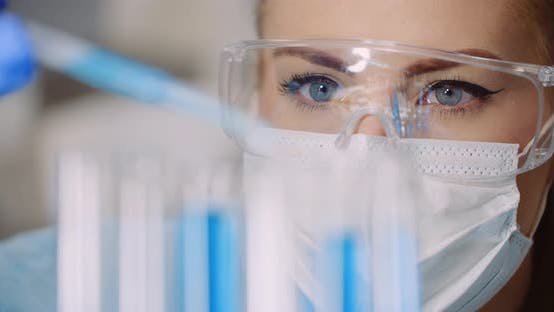 Thumbnail for Doctor Carefully Drips Medicine From Pipette Into Sample Glass Tubes for DNA Analysis at Laboratory