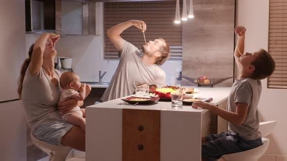 Happy Family Enjoy Dinner Together