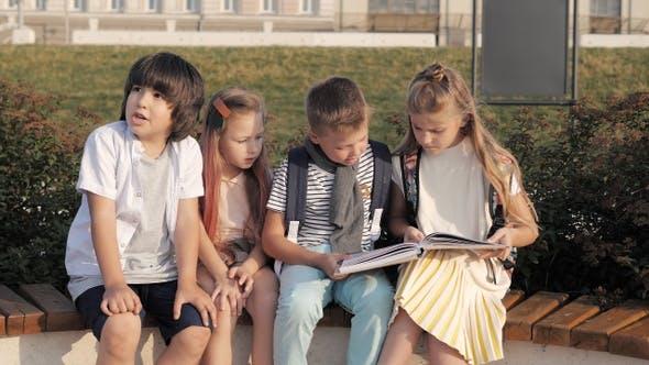 Thumbnail for School children reading boring book.
