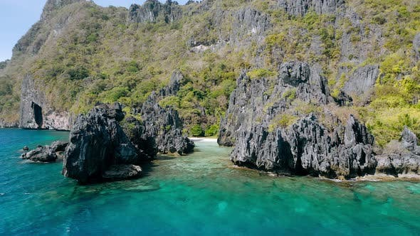 Thumbnail for Aerial Drone View Over a Tropical Coral Reef and Rocky Formations Hidden Beach, El Nido Palawan