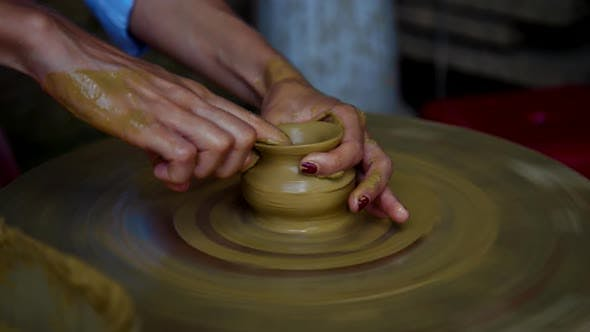 Thumbnail for Woman Hands Make Clay Vase Neck on Rotating Potter Wheel