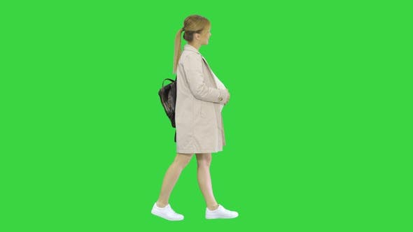 Happy Healthy Pregnancy Pregnant Young Blonde Caucasian Woman Walking on a Green Screen Chroma Key