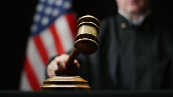 Thumbnail for Judge Hammering With Wooden Gavel Against American Flag In United States Court Room