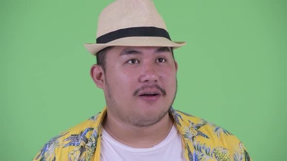 Thumbnail for Face of Happy Young Overweight Asian Tourist Man Getting Good News