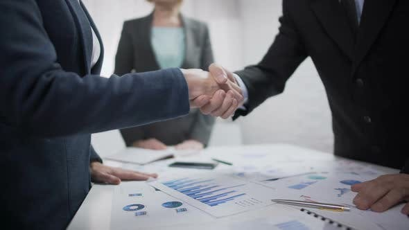 Company Representatives Handshaking After Contract Sign, Partnership Symbol