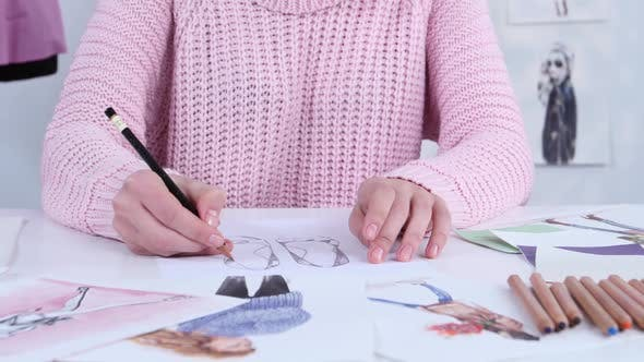Thumbnail for Designer Dress Hands Create Beautiful Drawings with Pencils for the Clothing Magazine. Close Up