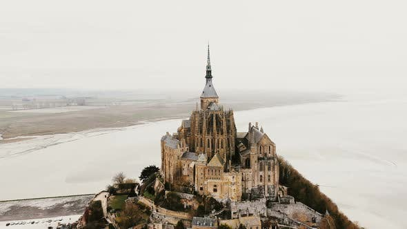 Thumbnail for Amazing Aerial View, Drone Flying Right Around Mont Saint Michel Abbey in Famous Tidal Island Town