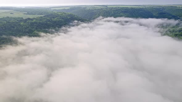 Drone Descends From Height Down Into Foggy Haze