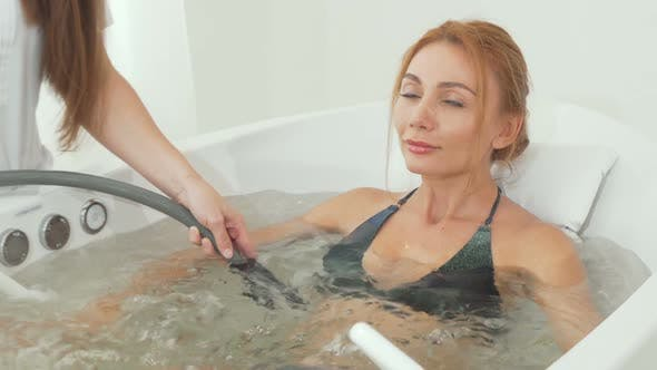 Cover Image for Beautiful Woman Receiving Hydro Massage in Whirl Pool Bath