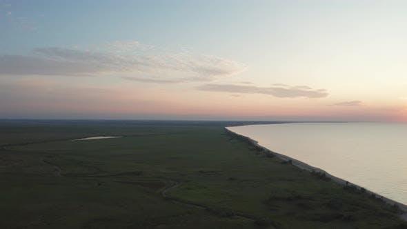 Thumbnail for Drone Shot of Green Azov Sea Coastline at Dusk
