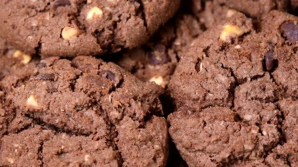 Thumbnail for Oatmeal cookies with cocoa, chocolate and hazelnuts rotating close-up