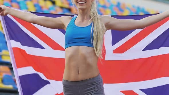 Thumbnail for Joyful sportswoman enjoying victory in sports competition and holding UK flag