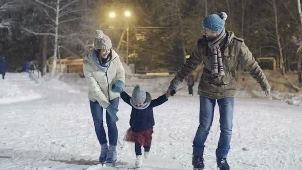 Thumbnail for Young Family Ice Skating in Winter