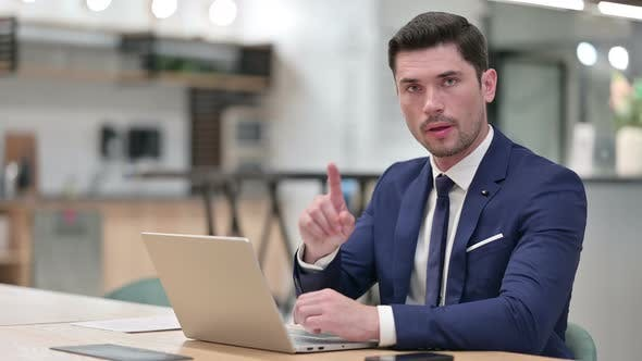 Thumbnail for No Sign By Businessman Working on Laptop in Office