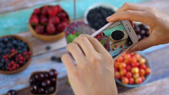 Thumbnail for Taking Photo of Smoothies with Chia Seeds and Berries on the Wooden Table.