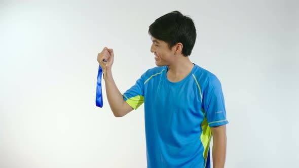 Man Celebrating With Golden Medal