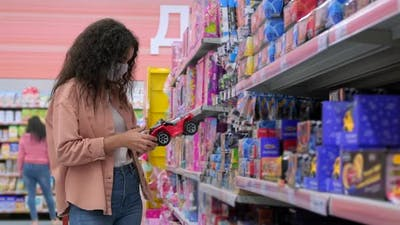 Customer Buying Toys in the Superstore