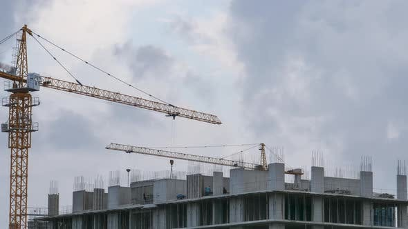 Thumbnail for Building Construction. Tower Crane on a Construction Site. Builders Work