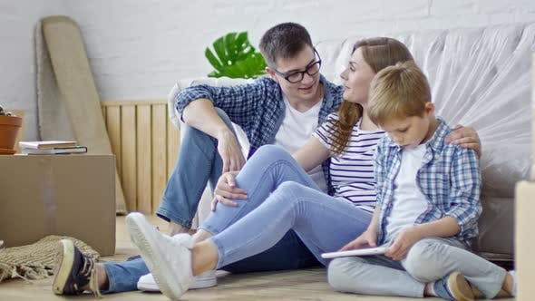 Thumbnail for Couple with Son in New House