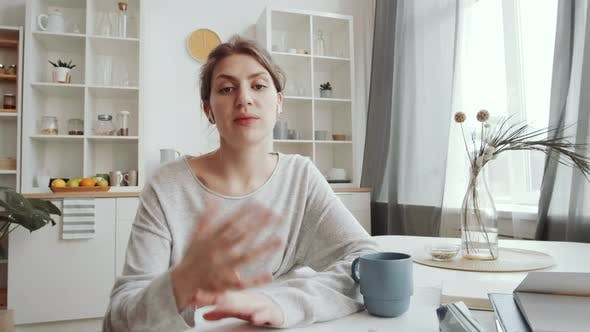 Thumbnail for Young Positive Woman in Wireless Earphones Talking on Web Call at Home
