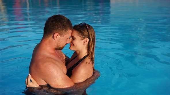 Thumbnail for Young Loving Couple Embracing in the Pool
