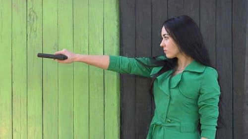 Firearms in hands of girl
