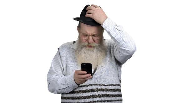 Portrait of Senior Man Surfing Internet on Mobile Phone