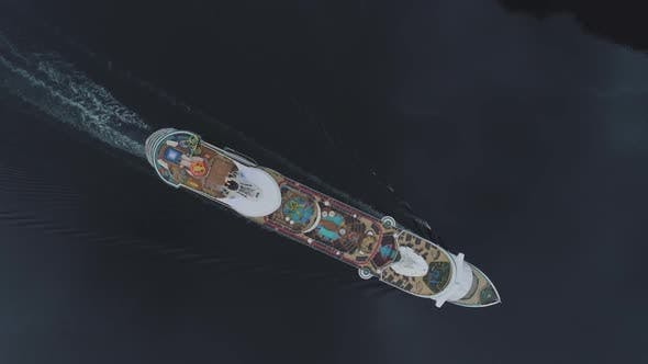 Thumbnail for Large Luxury Cruise Ship Is Going in Fjord of Norway. Aerial Vertical Top-Down Diagonal View
