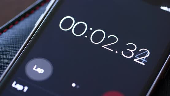 Thumbnail for Numerical digital stopwatch with white number and black screen on cellphone