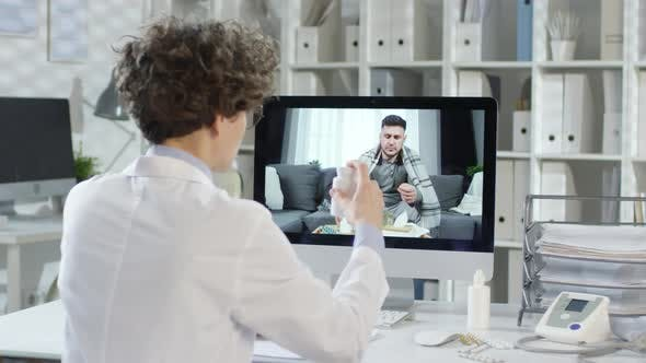 Thumbnail for Doctor Having Online Talk with Ill Man