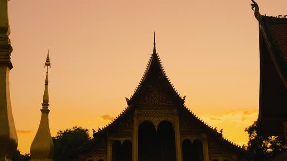 Thumbnail for 4K Entrance to a Buddhist Temple at Sunrise