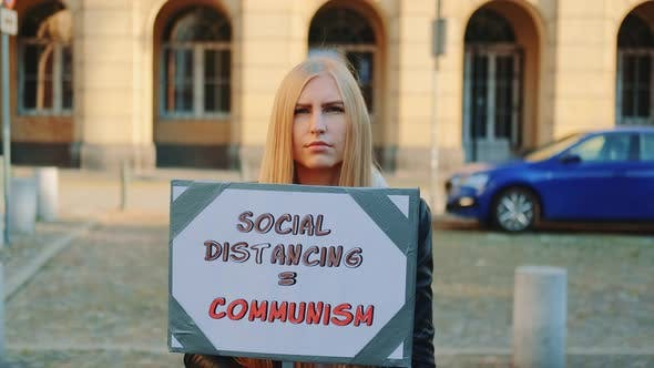 Woman's Protest Walk with Steamer Against Social Distancing That Equals Communism
