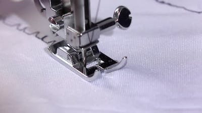 Seam with Different Tension of a Black Thread. Slow Motion