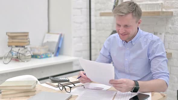 Thumbnail for Excited Businessman Studying Documents