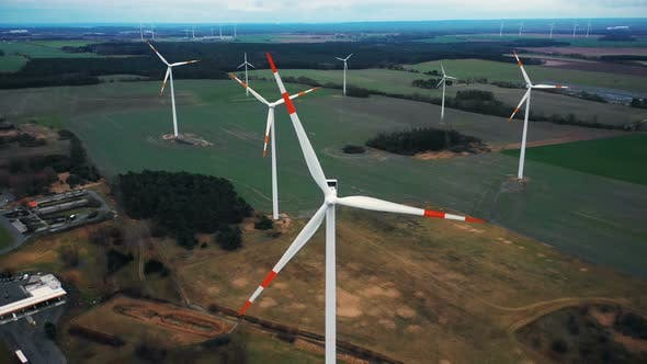 Thumbnail for Amazing Aerial Close-up Shot, Flying Above Windmill Turbines Farm in Autumn Field