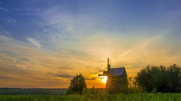 Thumbnail for Sunrise and an Old Wooden Windmill