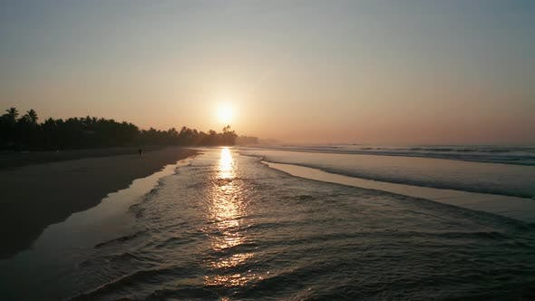 Thumbnail for Sunrise on a Sandy Beach in the Southern Part of the Island of Sri Lanka. Surfers