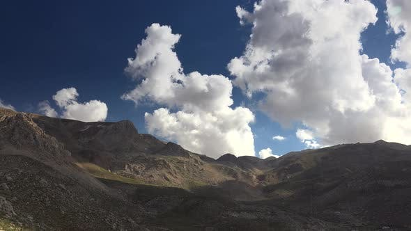 Thumbnail for Camera Movement Rotating With Clouds in Treeless Mountainous Hills