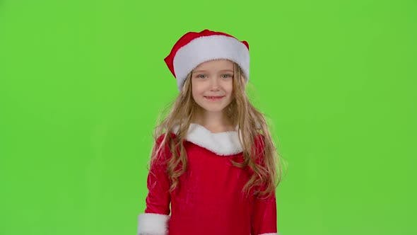 Thumbnail for Child in Red Christmas Caps Send Air Kisses. Green Screen