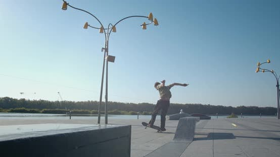 Thumbnail for Stunning Kickflip Performed By a Skater Boy at the Park,