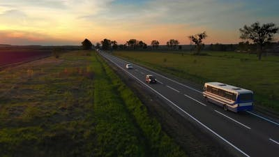 Aerial Drone View Cars Bus and White Semi Truck Driving By Road
