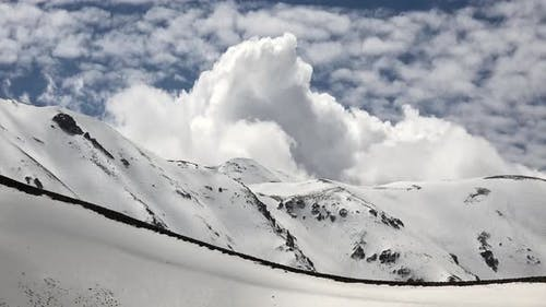 Snowy Mountain Ridge Under Thermal Ripple Created by Warm Air