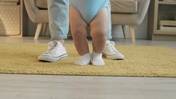 Infant Making First Steps