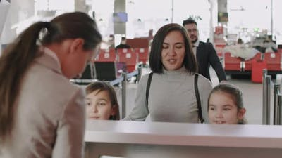 Woman With Children Checking-In