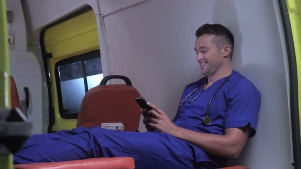 Thumbnail for Corpsman Sit on Stretcher in Ambulance Car