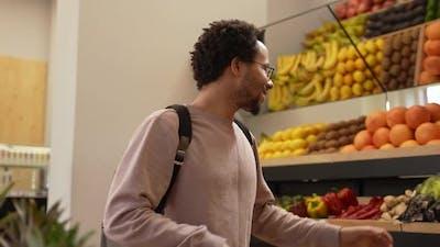 Vegan Buyer Choosing Fresh Vegetables in Farm Shop