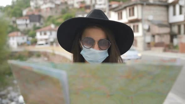 Thumbnail for Close Shot of Woman with Face Mask and Sunglasses Exploring Map in Old Town